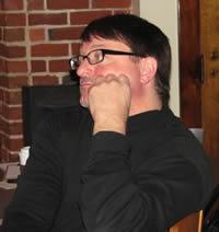 photo of David Huber looking thoughtful, tired, or both.