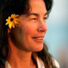 photo of Joanne Rand with a flower in her hair