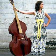 photo of Megan standing next to her instrument