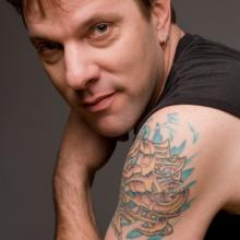 photo of Phil Circle showing a tatto on his left shoulder